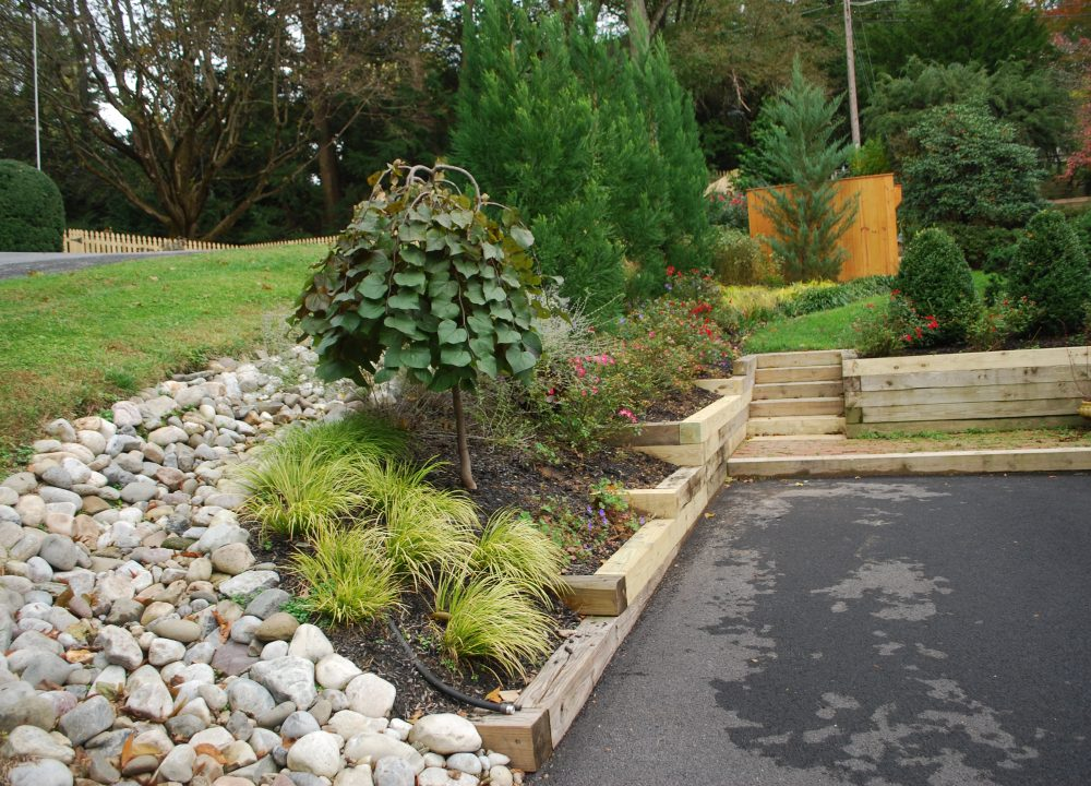 stone swale in yard   drainage solution   drainage issue in yard