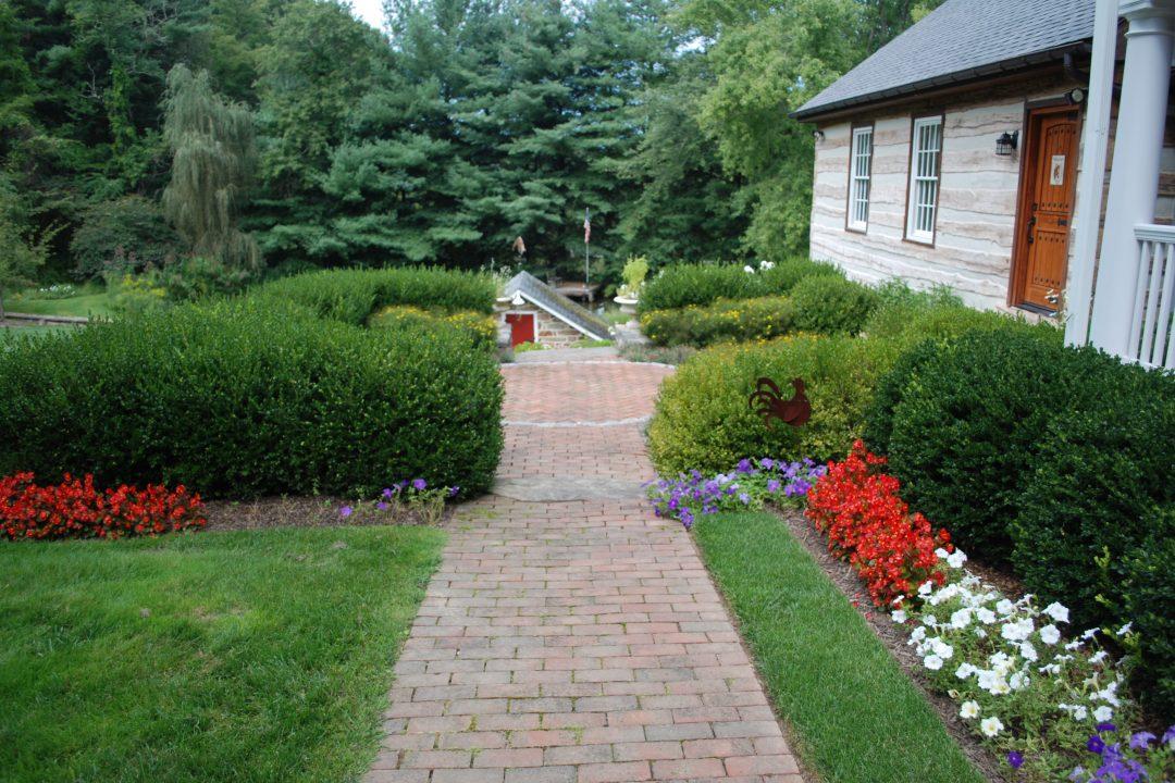 brick sidewalk along flower beds landscape
