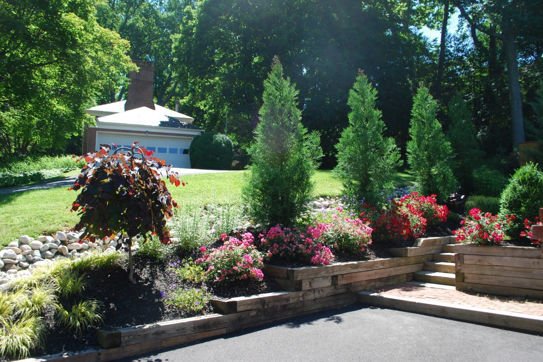 flower beds along retaining wall next to driveway